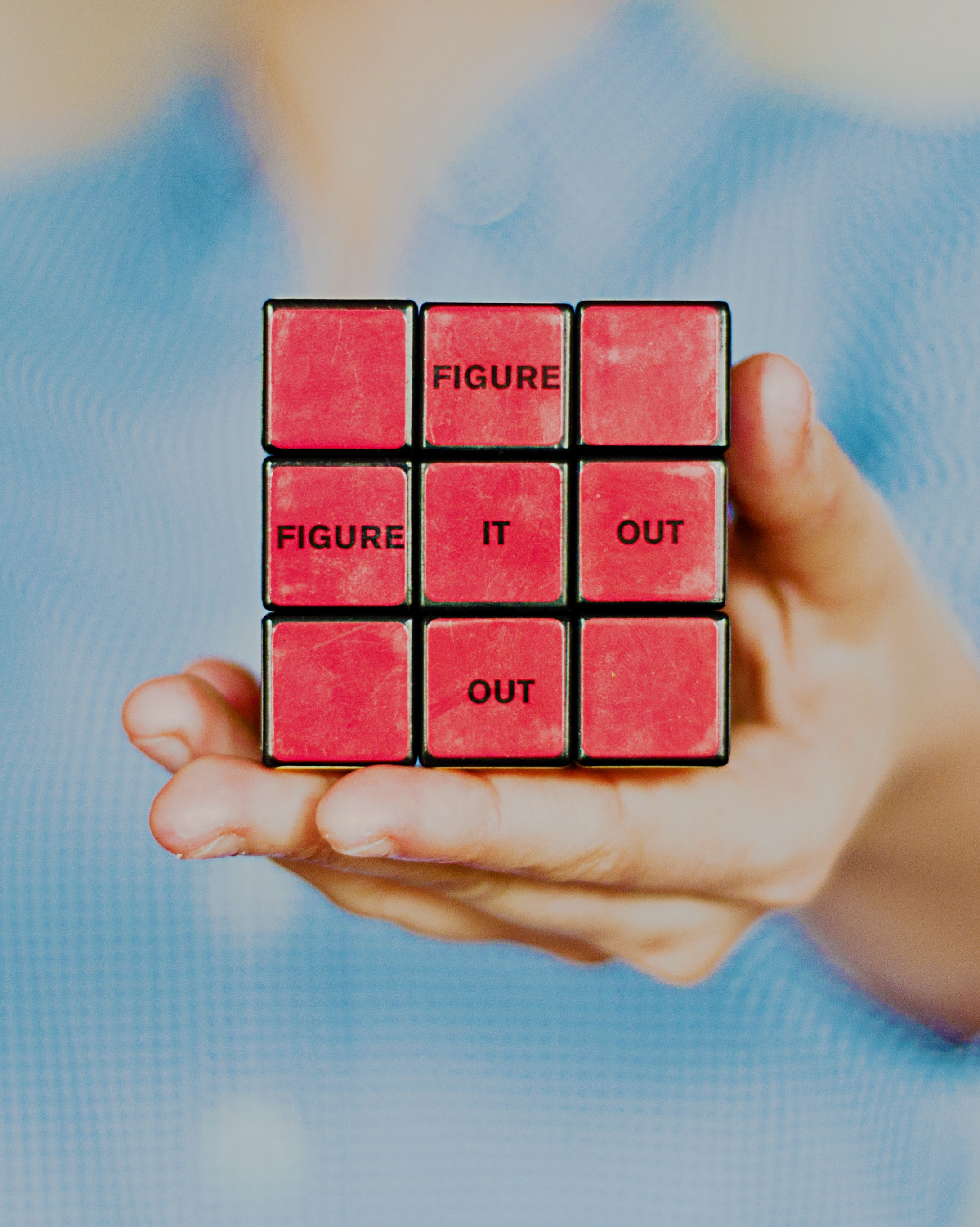 "image of rubik's cube with words ""figure it out"" on the tiles"